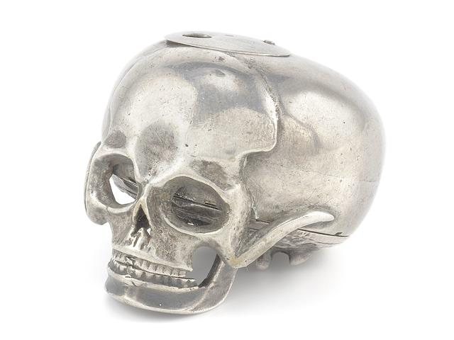 Richard Rooker, London. An unusual silver skull form key wind momento mori watch Circa 1710