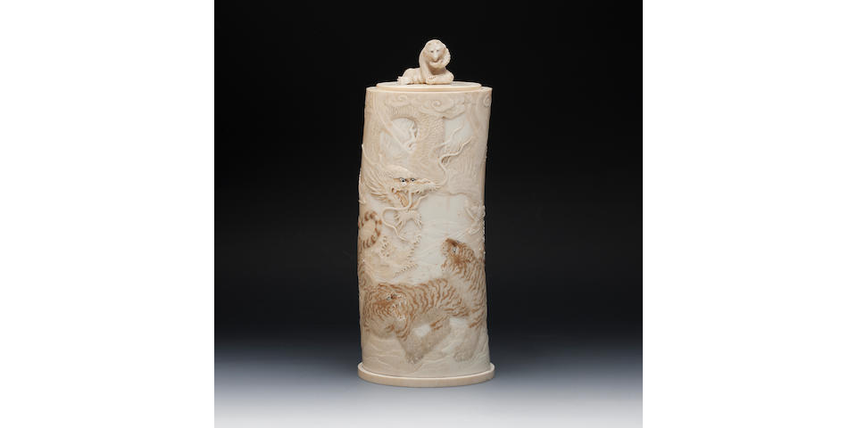 A carved ivory tusk vase and cover  Signed Tomioka, Meiji