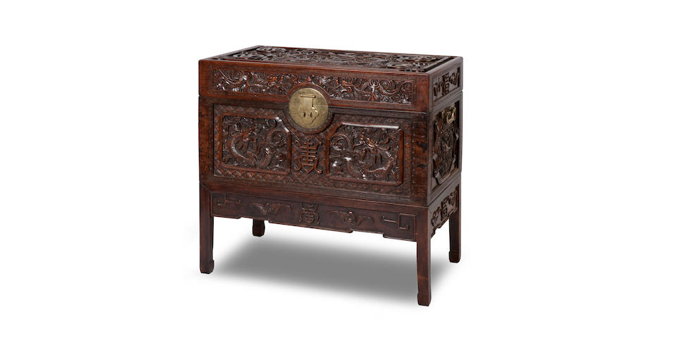 An impressive huanghuali carved trunk on stand 19th century