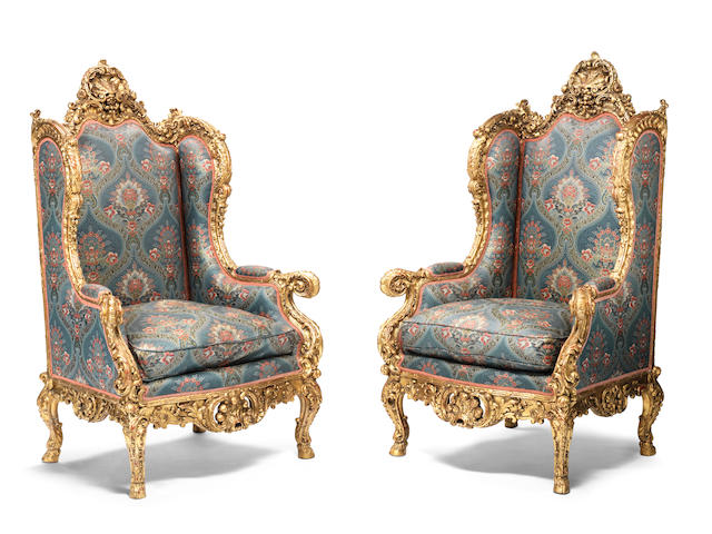 A pair of French late 19th/ early 20th century Louis XV style carved giltwood bergères à oreilles (2)