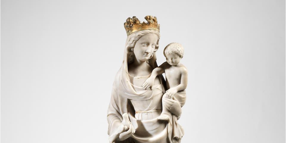 A second quarter 14th century French (Ile-de-France) marble figure of the Virgin and Child