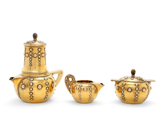 A good French  silver-gilt three-piece coffee service by Lucien Falize, underside of the pot also inscribed 'Falize Orf. Paris' Paris, circa 1900  (3)