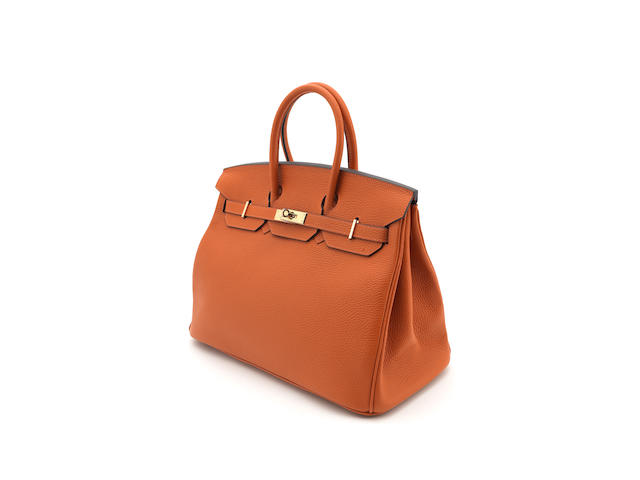 HERMÈS: An orange leather 'Birkin' handbag 2013 dater letter stamp, also stamped 70A,