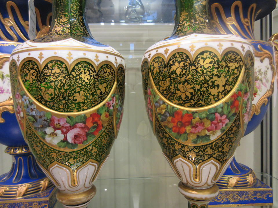 A pair of Bohemian green glass overlay vases Circa 1900