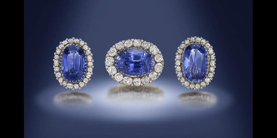 A sapphire and diamond cluster brooch and earring suite (2)