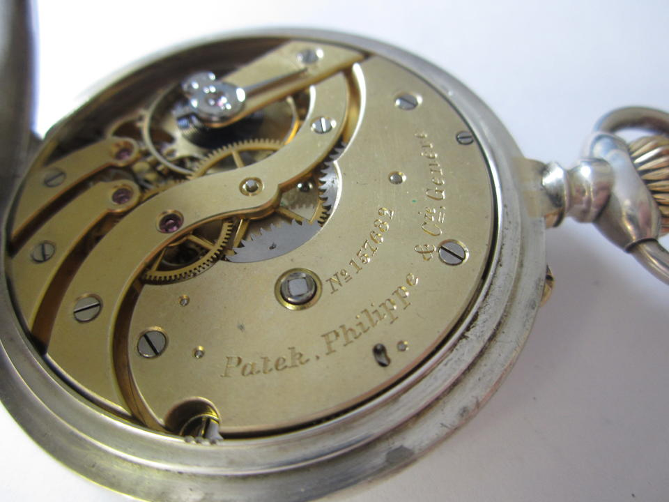 Patek Philippe. An unusual silver keyless wind open face pocket watch Case and Cuvette No.264257, Movement and Cuvette No.157682, Circa 1910
