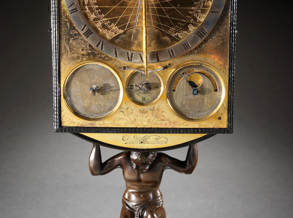 An important mid 17th century German bronze mounted ebony table clock with vertical sundial,  Davidt Buschmann