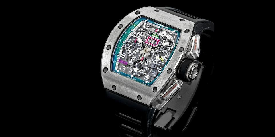 Richard Mille. A limited edition titanium skeletonised automatic calendar flyback chronograph wristwatch Felipe Massa, Ref:RM011 AJ Ti/1375, No.130/150, Movement No.089790, Circa 2011