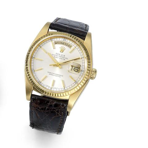 Rolex. An 18K gold automatic calendar wristwatch Day-Date, Ref:18038, Serial No.806****, Movement No.215****, Circa 1983