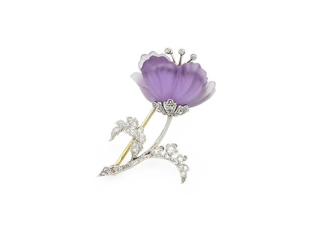An early 20th century amethyst and diamond flower brooch, by Plisson & Hartz