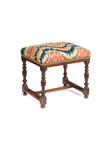 An early 18th century fruitwood  stool, French, circa 1700 - 40