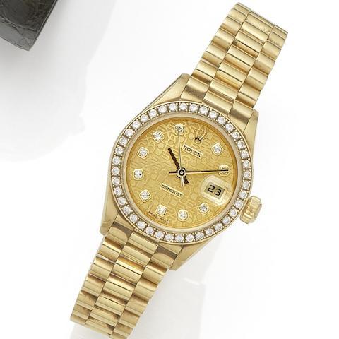 Rolex. A lady's 18K gold and diamond set automatic calendar bracelet watch Datejust, Ref:79138, Serial No.P19****, Movement No.034****, Circa 1999