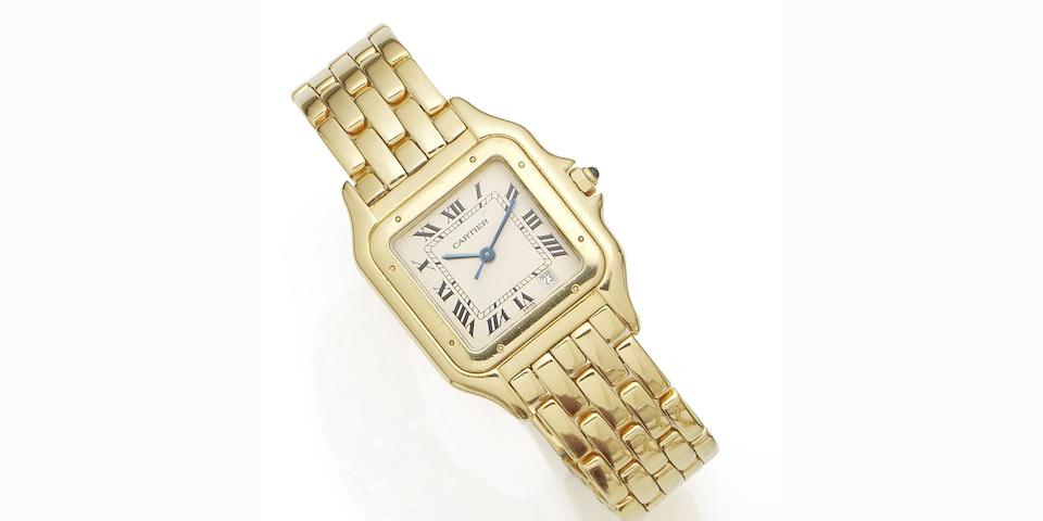 Cartier. An 18K gold quartz calendar bracelet watch Santos, Case No.8839540162, Circa 1990