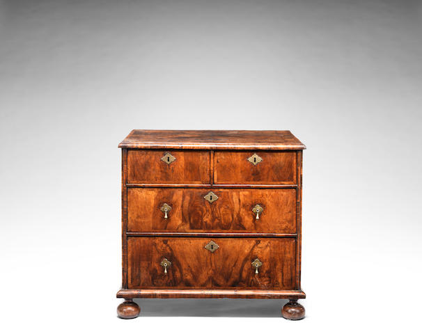 A small William and Mary walnut crossbanded and featherbanded chest