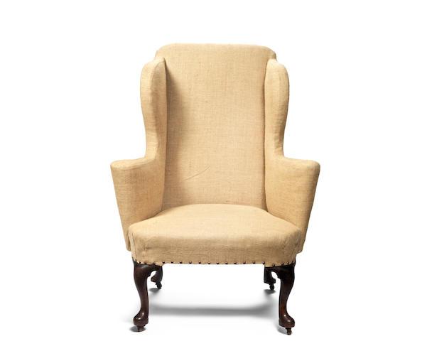 A George II mahogany wingback armchair
