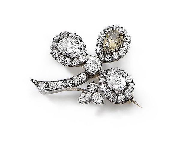 An early 20th century diamond and fancy coloured diamond brooch
