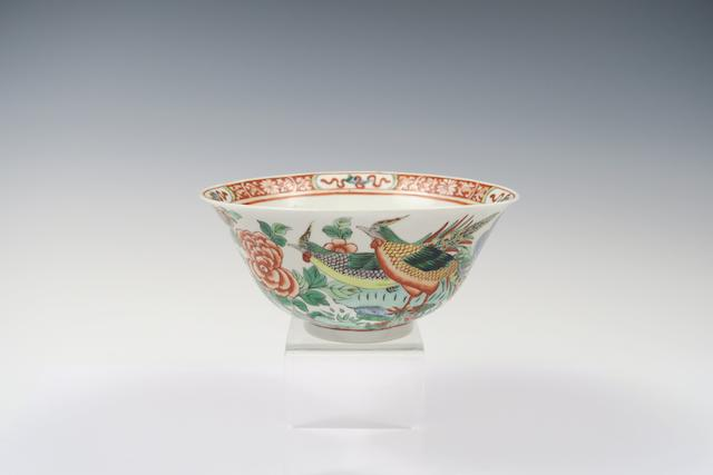 A famille rose bowl Bearing a Kangxi six-character mark but 19th century