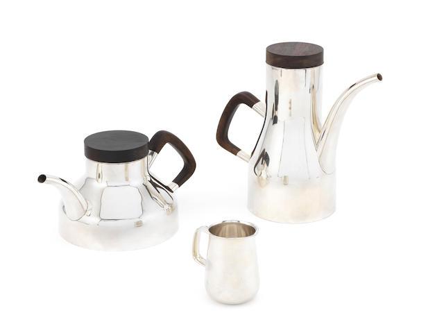 ROBERT RADFORD WELCH: A silver coffee pot, tea pot and cream jug, designed for Heals Birmingham 1972 and 1973, the teapot London 1975 (3)