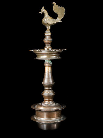 A brass lamp with hamsa Finial Deccan, 17th/ 18th Century