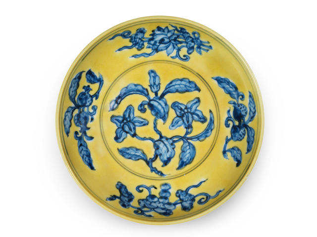 A rare underglaze-blue yellow-ground 'gardenia' saucer dish Zhengde six-character mark and of the period