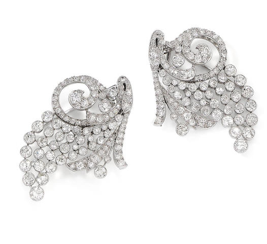 A pair of diamond clip brooches, (2)