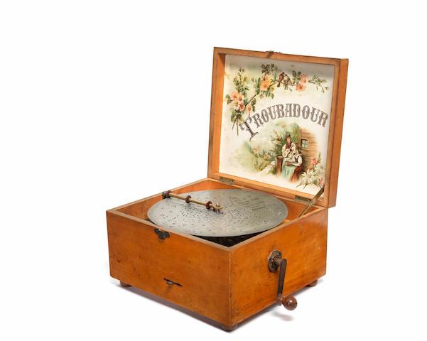 An 8 3/4 inch Troubadour disc musical box, German, Circa 1910,