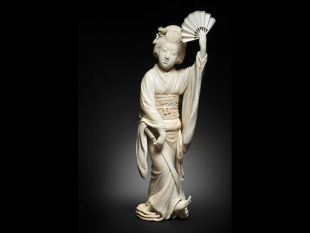 A fine large ivory okimono of a dancer By Yoshida Doraku, Meiji era (1868-1912)