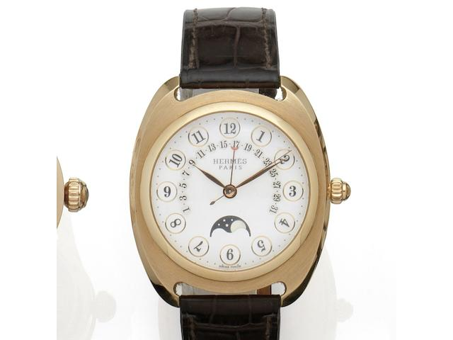 Hermes. An 18K rose gold automatic calendar wristwatch with moon phase Ref:DR2.770, No.59/200, Movement No.013152, Circa 2012