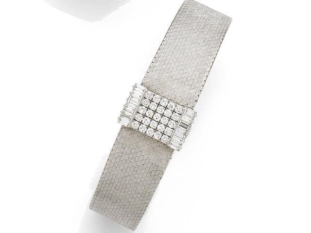 Patek Philippe. A lady's 18K white gold and diamond set manual wind bracelet watch with concealed dial Retailed by Beyer, Ref:3319/9, Case No.2635702, Movement No.984395, Circa 1965