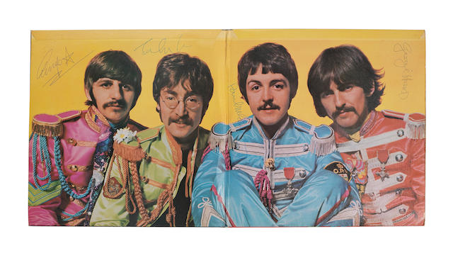 The Beatles: a rare autographed 'Sgt. Pepper's Lonely Hearts Club Band' album, signed on the gatefold sleeve by John Lennon, Paul McCartney George Harrison and Ringo Starr [later], 1967, Parlophone PMC 7027,
