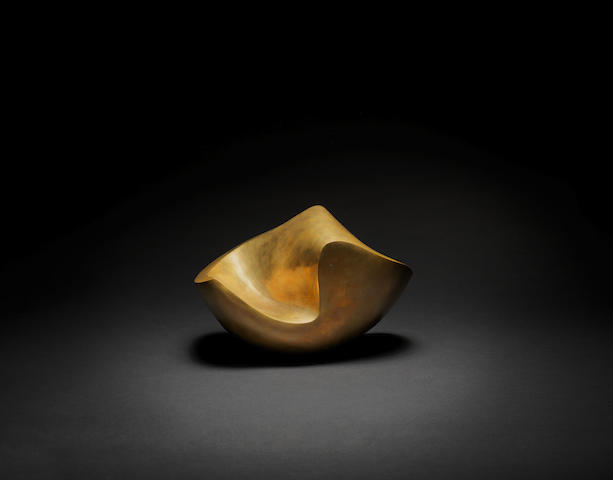 JEAN (HANS) ARP (1886-1966) Ganymède 21 x 31.7 x 25.5 cm (8 1/4 x 12 1/2 x 10 1/16in). (Conceived in 1954 and cast in an edition of 5 between 1957 and  1959 by Susse Fondeur. The present work is the first cast. Ganymède is a variant of the work Ecaille, conceived in 1938. )