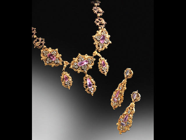 A topaz and gold repoussé necklace and pendent earring suite, (2)