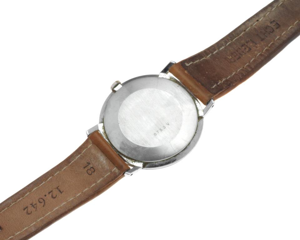 Girard Perregaux. A stainless steel manual wind wristwatch