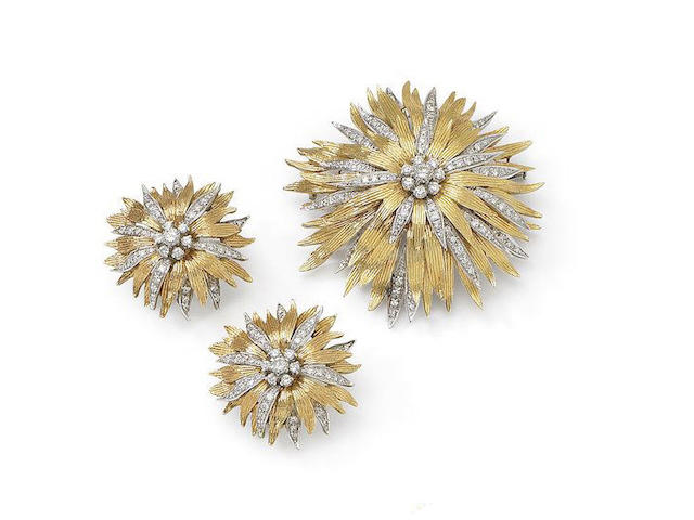 A diamond brooch and earclip suite, retailed by Garrard, (2)