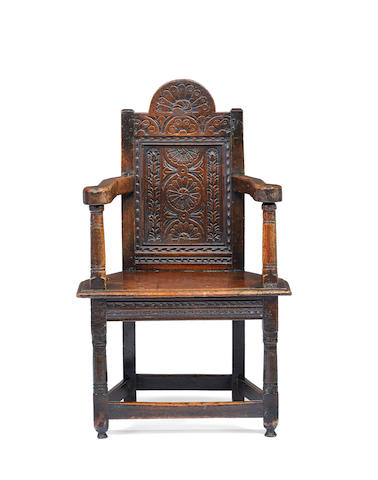 A rare James I joined oak adolescents' caqueteuse armchair, Salisbury, circa 1610 - 20 In the manner of the acclaimed Humphrey Beckham workshop