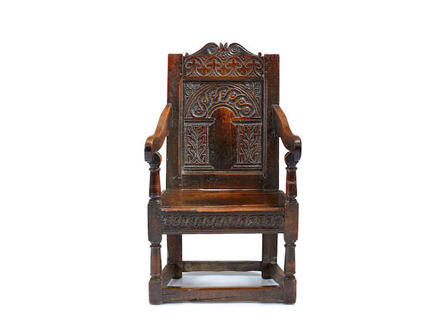 A good Charles I joined oak panel back open armchair, West Country, circa 1640