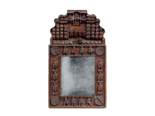 A rare carved cedar frame, Swiss, circa 1700 – 1740