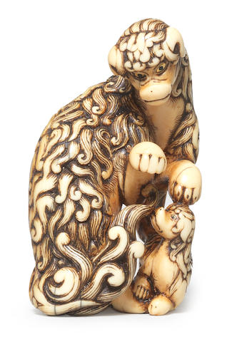 An ivory netsuke of a shaggy dog and pup By Gechu, late 18th/early 19th century