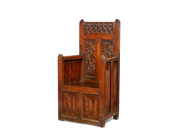 An exceptionally rare late 15th century joined oak enclosed armchair, Northern French, circa 1480 - 1500