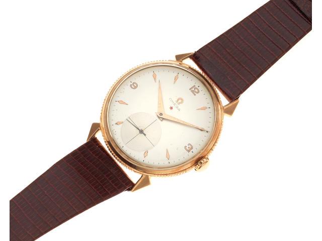 Omega. An 18K gold manual wind wristwatch Circa 1950