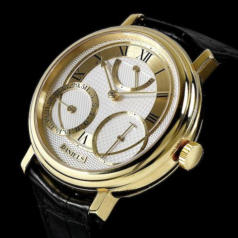 George Daniels. A very rare and fine 18K gold limited series manual wind instantaneous calendar wristwatch with power reserve indication, co-axial escapement and start stop mechanism, Daniels Anniversary Edition, No.24/35