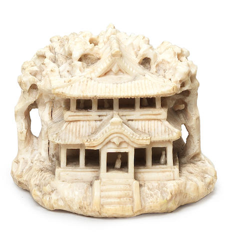 An ivory netsuke of temple buildings By Kagetoshi, Kyoto, 19th century