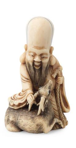 An ivory netsuke of Jurojin By Raku, Osaka, early 19th century