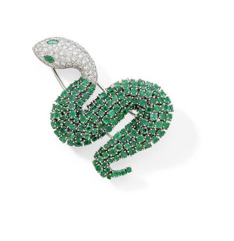 An emerald and diamond brooch in the shape of a snake