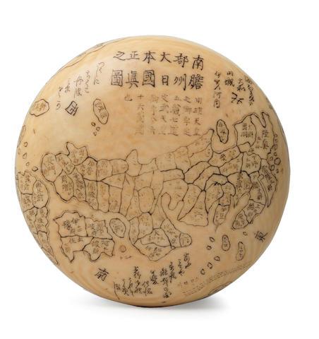 An ivory manju netsuke engraved with a map of Japan By Ichimuken Nanka, Izumi Province, 19th century