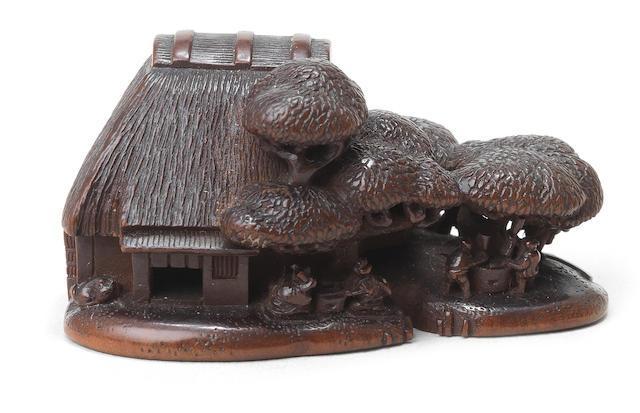A wood netsuke of a peasant family By Horaku, Kyoto, 19th century