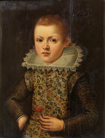 Anglo-Flemish School, early 17th Century Portrait of a boy, half-length, holding a flower
