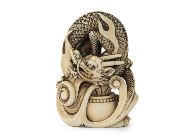 An ivory netsuke of a dragon By Yoshimasa, Kyoto, Edo period (1615-1868), late 18th/early 19th century