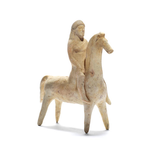 A substantial Corinthian terracotta statuette of a horse and rider