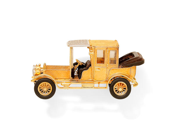 A novelty diamond-set model vintage Rolls Royce and a bangle
